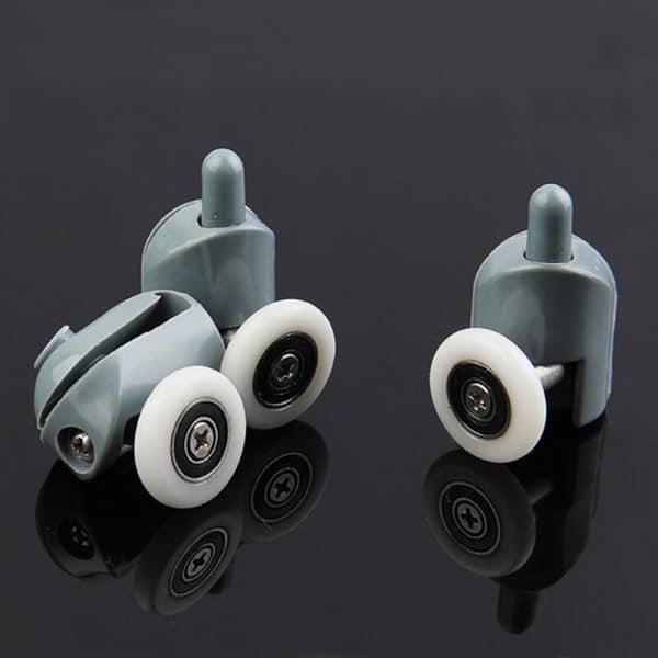 roulement à billes dans une bague en nylon ou plastique blanc c'est une roulette qui permet à une porte de douche de coulisser