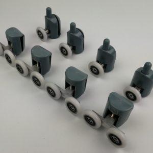 roulement à billes entourés d'une bande ronde en plastique ou nylon, c'est une roulette qui permet de faire coulisser une porte de douche